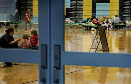 People took shelter in a high school gymnasium in Lewes, Del.