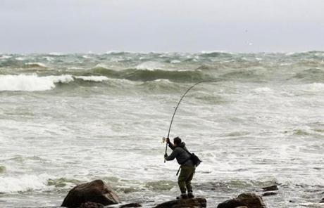 Turbulent waves didn't deter one fisherman in Montauk, N.Y., on Sunday.