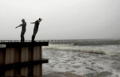 Two women braved the strong wind in Virginia Beach, Va.