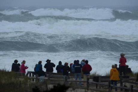 Sightseers stood at the end of a walkway to Nauset Beach in Orleans.