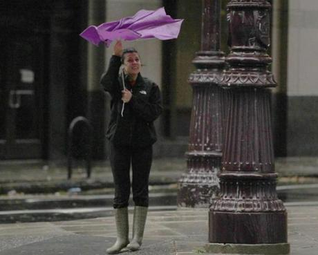 A pedestrian wrestled with her umbrella in Philadelphia.