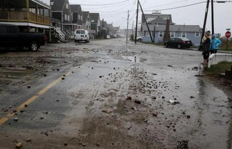Oceanside Drive was littered with debris in Scituate.
