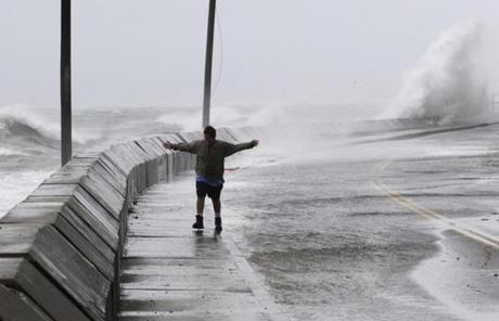Joe Gallion of Falmouth checked out the surf on Menauhant Road in Falmouth.
