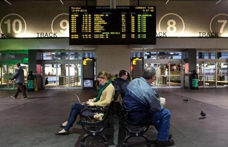 Commuters waited in Boston's North Station for Amtrak and MBTA service Monday morning.