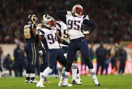 Chandler Jones, right, and Justin Francis celebrated after sacking Bradford.
