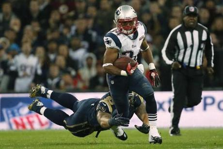Patriots running back Shane Vereen was caught by Rams defensive tackle Jermelle Cudjo.