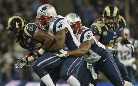 Jerod Mayo, center, and Dont'a Hightower applied pressure to the Rams' Janoris Jenkins.