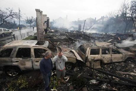 Residents looked over the remains of burned homes in the Rockaways section of New York.