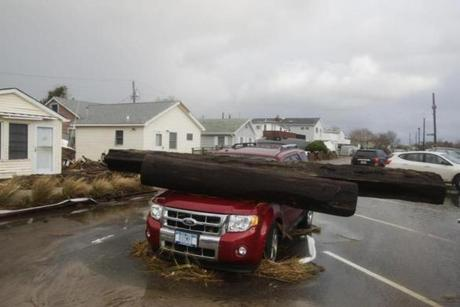 A log rested on a vehicle at Breezy Point in the New York City borough of Queens.