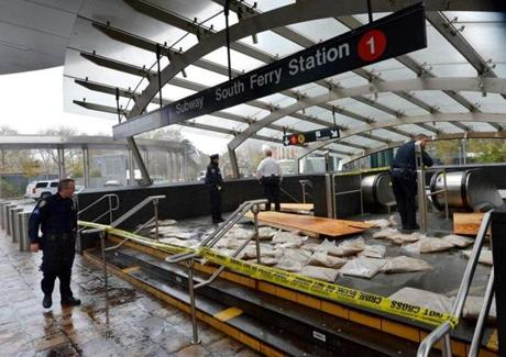 New York City police cordoned off a subway station after Hurricane Sandy left most of lower Manhattan without power.