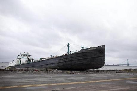 Storm surges from Sandy caused a 170-foot long tanker to run aground in Staten Island, N.Y.
