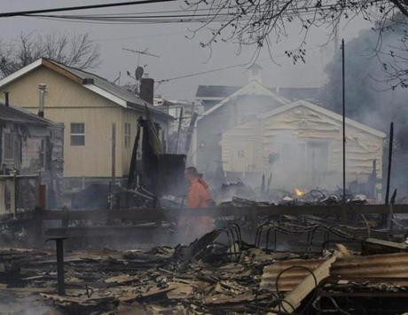 Keith Klein walked through homes damaged by the fire in Breezy Point.