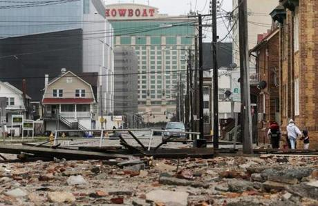 People walked past debris in the area where a 2000-foot section of the