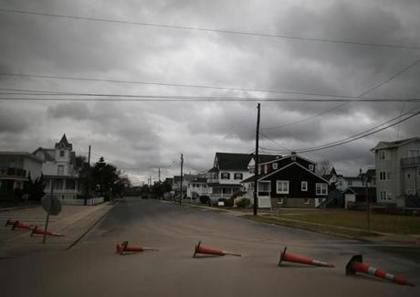 Weighted traffic cones were blown over from the high winds of Hurricane Sandy in Cape May, N.J.