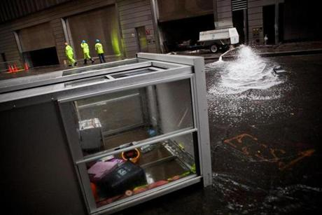 Con Edison employees monitored water being pumped out of Seven World Trade Center in New York on Oct. 30.