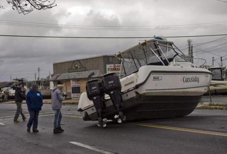 Residents photographed a boat resting on Broadway Avenue in Point Pleasant Beach, N.J.