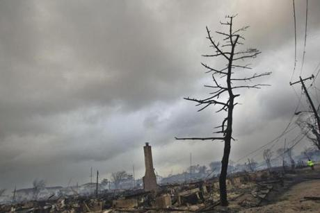 Charred remains of many homes were left in the Breezy Point neighborhood.