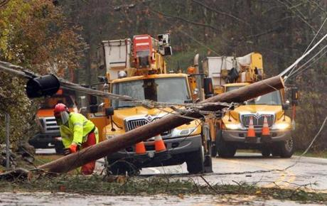 Crews worked to clean up downed power lines in Milton, N.H.