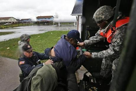 National Guard, Maryland State Police, and Crisfield police worked together to assist a resident in Crisfield, Md.