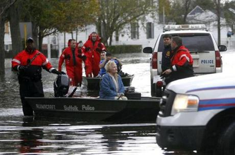 Elaine Belviso, 72, was rescued from her flooded home by police after being trapped there overnight in Babylon, N.Y.