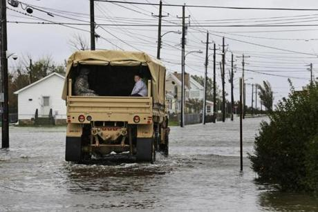 A resident rode in a National Guard truck as he and others are evacuated from their flooded neighborhood in Crisfield, Md.