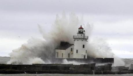 Waves pounded a lighthouse on the shores of Lake Erie near Cleveland.