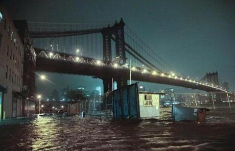 Streets were flooded under the Manhattan Bridge in the Dumbo section of Brooklyn, N.Y.