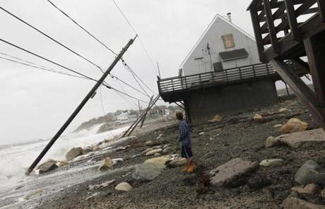 A child looked at power lines knocked down by Hurricane Sandy in Scituate.