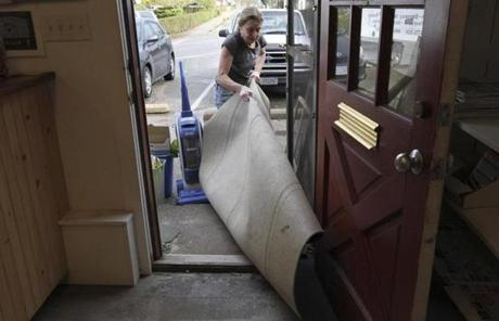 A woman dragged a wet rug out of her gallery in Falmouth Harbor.