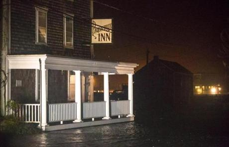 Water rose to the porch at the Paquachuck Inn in Westport.