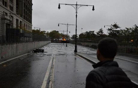 A tunnel under Battery Park in lower Manhattan was flooded early Tuesday.