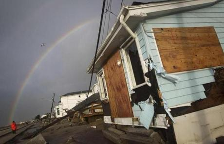 In the Queens, N.Y., a rainbow could be seen behind homes devastated by the storm.