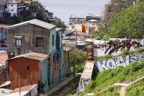 Despite its recent facelift, Valpara'so is no anodyne tourist village. Graffiti-covered walls remain a noted part of the city.