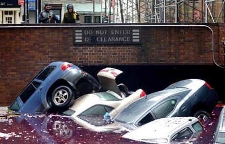 The storm left cars partially submerged in a New York City parking lot.