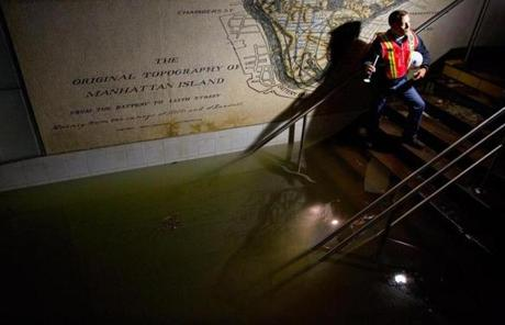 A Metropolitan Transit Authority official shined a light on standing water in the South Ferry 1 train station.