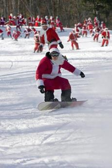 On Santa Sunday, participants wearing Santa suits can ski for free.