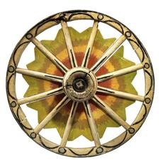 Wagon wheel from the late 19th century made of painted wood and metal. Photographer: Bruce White.