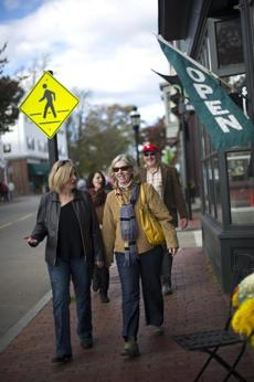 Debbie Dolliver, of Martha's Vineyard, left, and Jean Golicz, of Old Saybrook, Ct., strolled down Bellevue Ave., with fellow participants of the Newport Gourmet Tour.