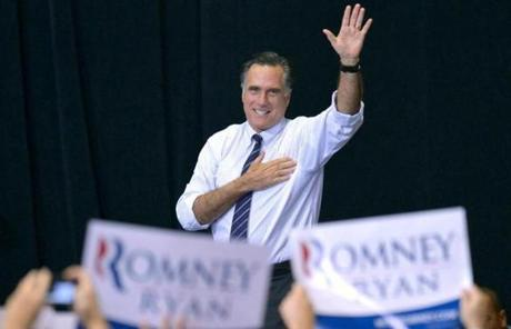 Mitt Romney waved at a rally at George Mason University in northern Virginia.