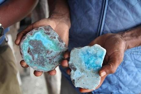 A miner shows off samples of the semi-precious larimar stone found only in the DR. The Los Chupaderos region of the Sierra de Baoruco mountain range has hundreds of mine shafts, and visitors and buyers are welcomed.