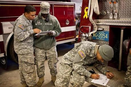 Members of the Army National Guard filled out absentee voter ballots for the presidential election while temporarily stationed along the New Jersey coastline to help with the recovery from Sandy.