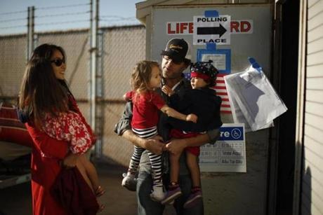 George Klein, Jenine Kanell, and their children lined up to vote at a Venice Beach lifeguard station in Los Angeles.