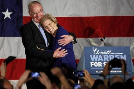 Senator-elect Elizabeth Warren hugged her husband, Bruce Mann, on election night after delivering her  victory speech at the Fairmont Copley Plaza hotel in Boston.