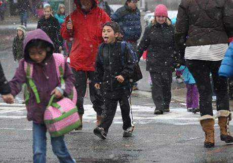 Diego Firmo, 8, tried to catch some snowflakes with his tongue as students left the Angier Elementary School in Newton at the beginning of the nor'easter.