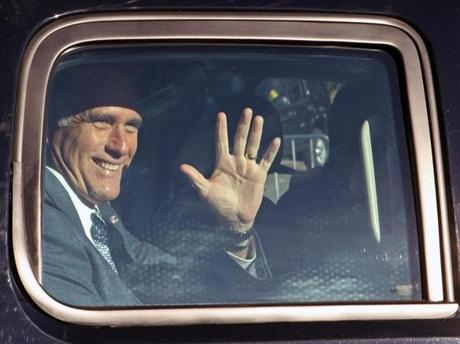 Mitt Romney waved to a crowd of supporters after voting at the Beech Street Center in Belmont.