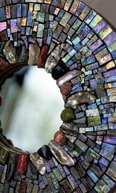 A mosaic mirror by artist Ariel Finelt Shoemaker, who works out of her studio in Needham.