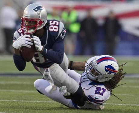 Brandon Lloyd was tackled by the Bills' Stephon Gilmore during the third quarter.