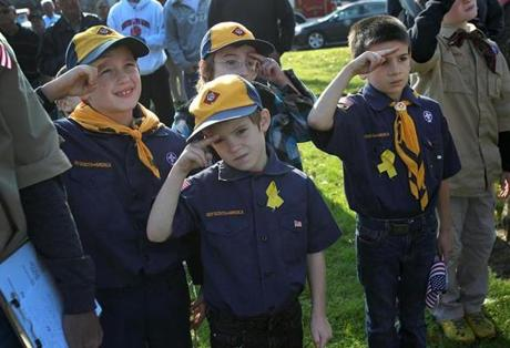 Clinton, MA., 11\12\12 Local officials including Lt. Governor Tim Murray, came to Hamilton Square to dedicate a memorial to World War I veterans. Clinton's Wolf Scouts Den 6, Pack 7, saluted during the dedication. Left to right, Aiden Cullen, 7, Pete Duffy 7, (he's in front), Miles Pitts, 7, Devin Smith, 7, all cq. Section: Metro Suzanne Kreiter/Globe staff