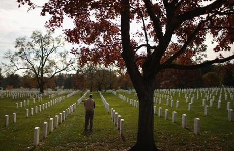 On Monday, a man paused between rows of headstones at Arlington National Cemetery  in Arlington, Virginia.