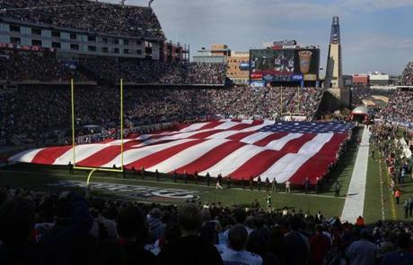 Veterans in a pre-game flag ceremony  Sunday at Gillette Stadium in Foxborough.